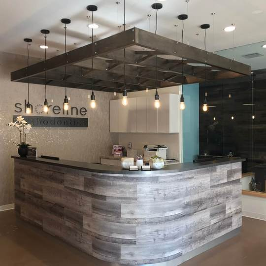 Even before you can make an impression on a client, your reception are already has. With well thought out, practical and decorative lighting, this Shoreline office is sure to impress.